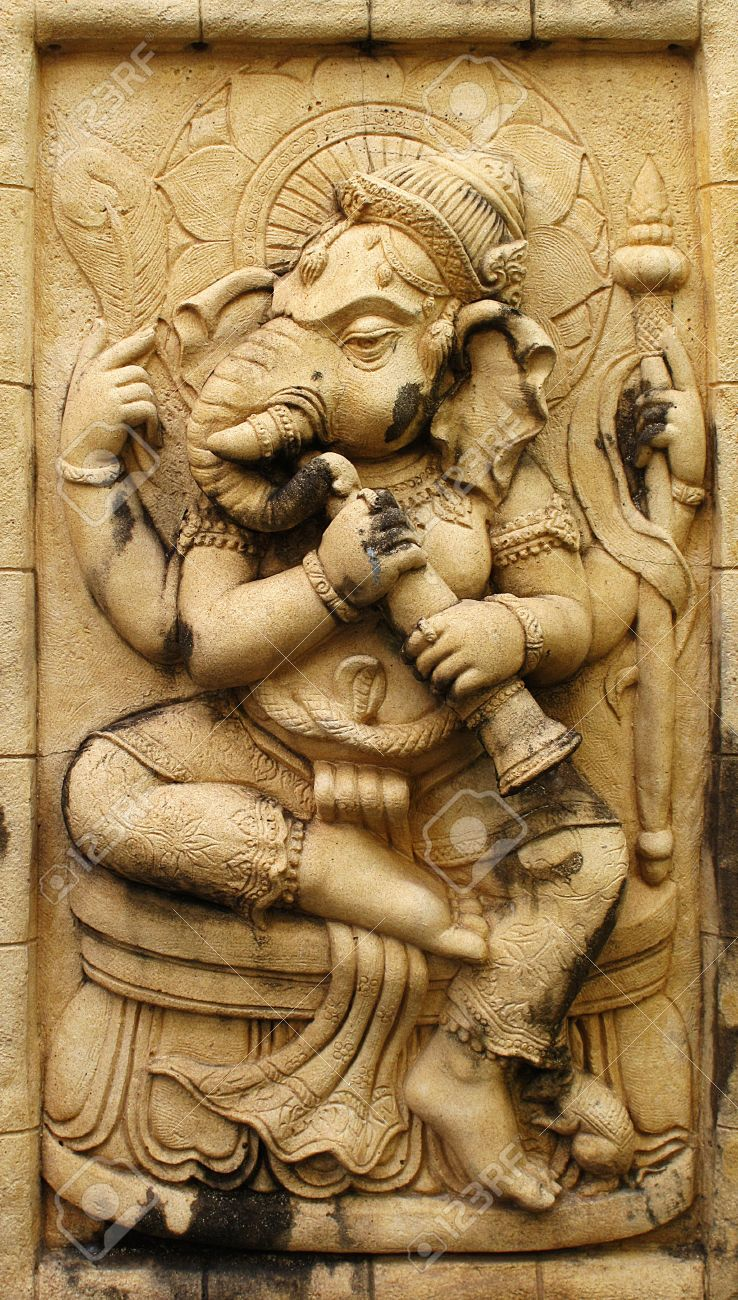 Ganesh hindu god made from stone carving stock photo picture and