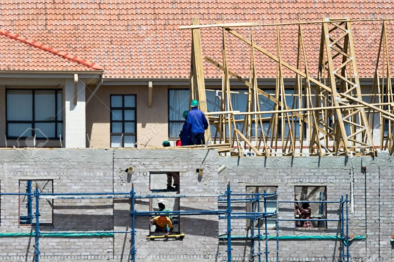 construction workers climbed on scaffolding, house new structure Stock Photo - 871359
