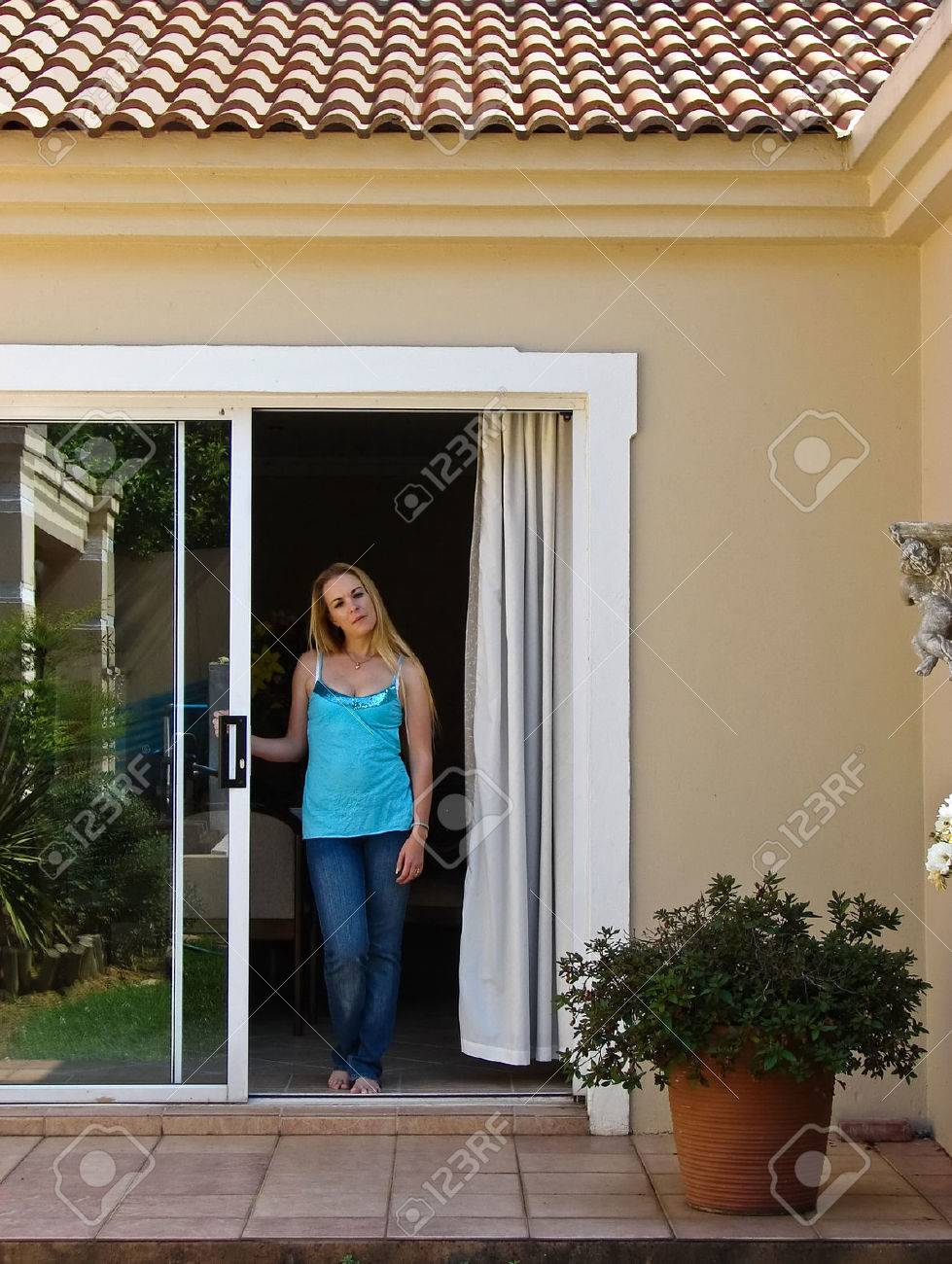 Young Blonde woman waiting in the house, people diversity Stock Photo - 2113264