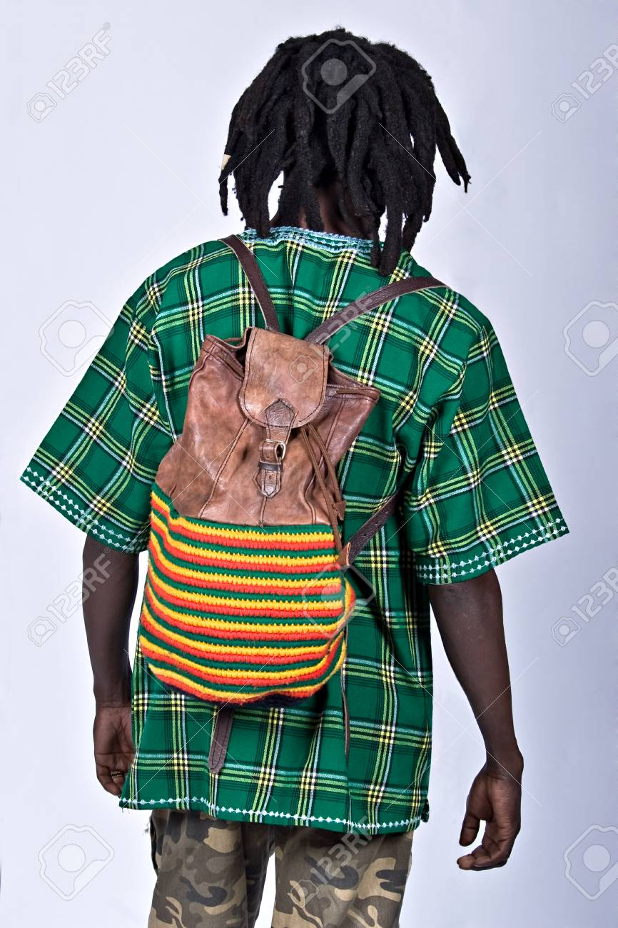 rasta man in traditional cloth with backpack, people diversity series Stock Photo - 1481496