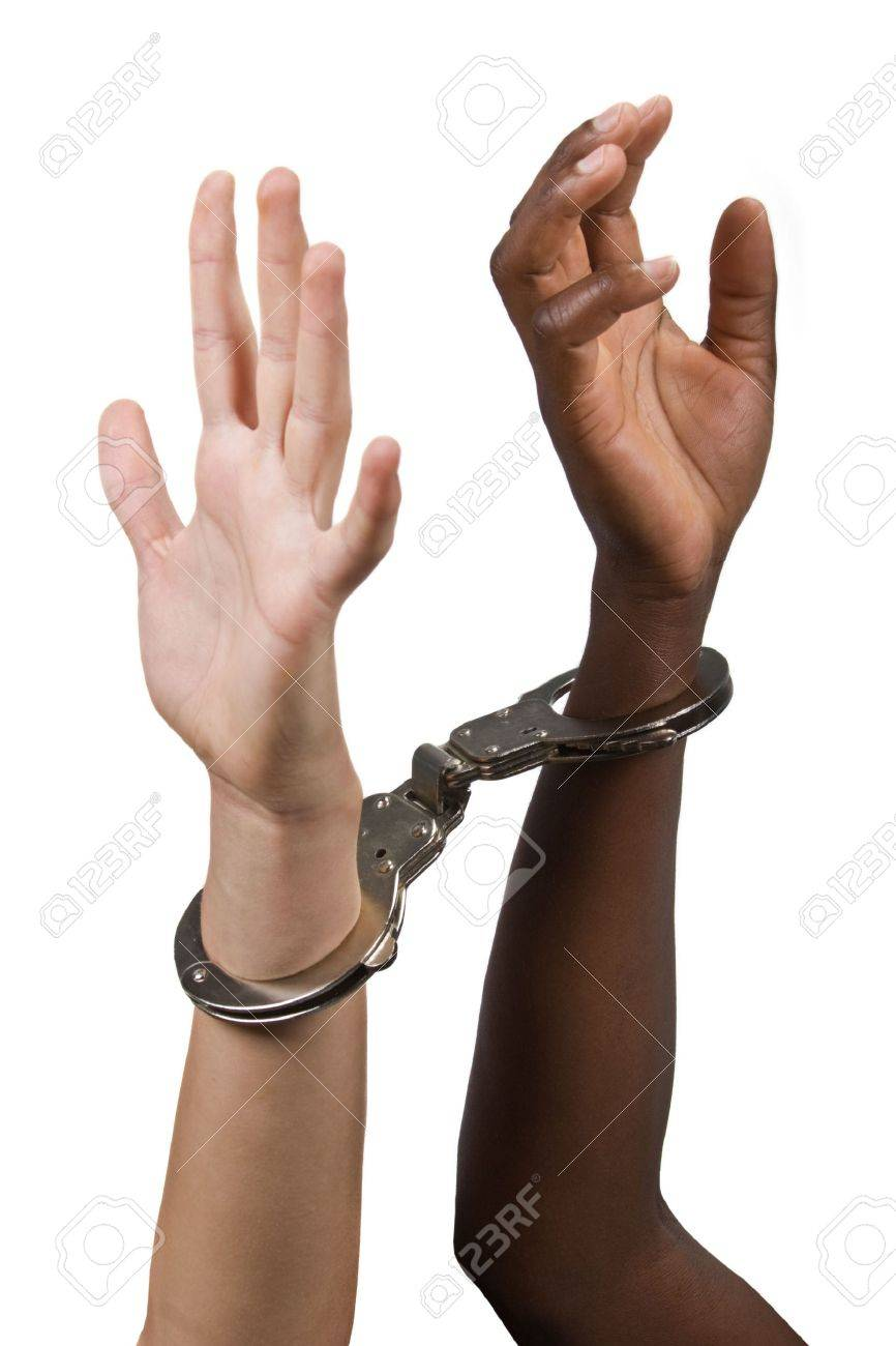 Mixed race hands Caucasian African American, man and woman, with handcuffs Stock Photo - 2595989