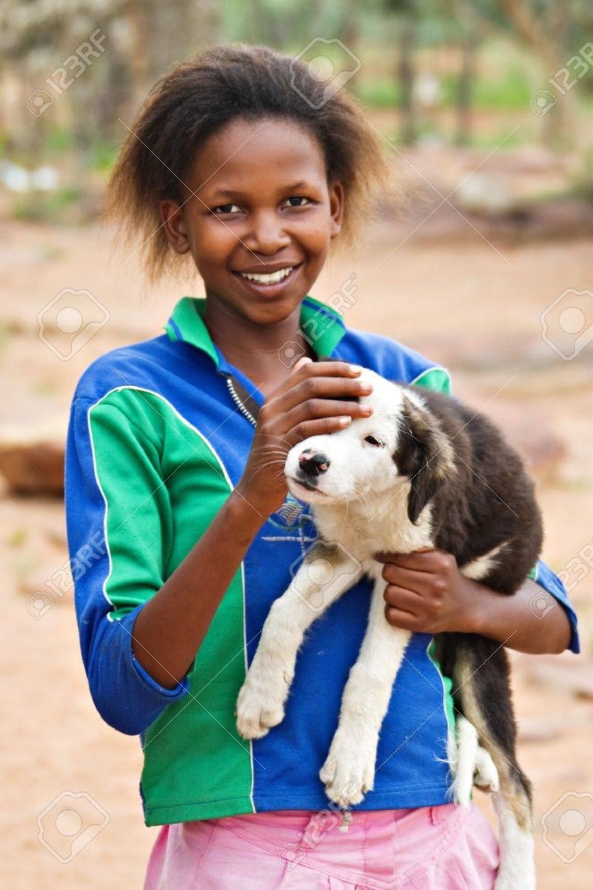 African girl with dog, picture taken in village near Kalahari Desert Stock Photo - 4126146