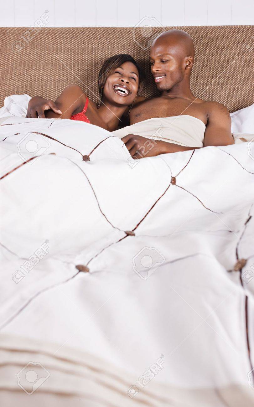 african american couple in bed having fun Stock Photo - 4118331