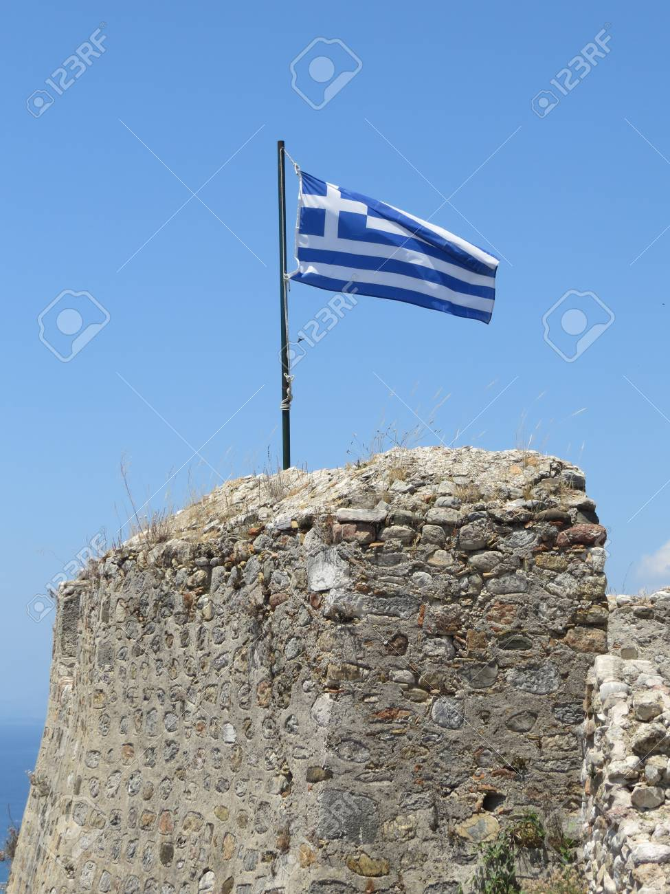 Greek flag on a bright pure blue sky background Stock Photo - 90295526