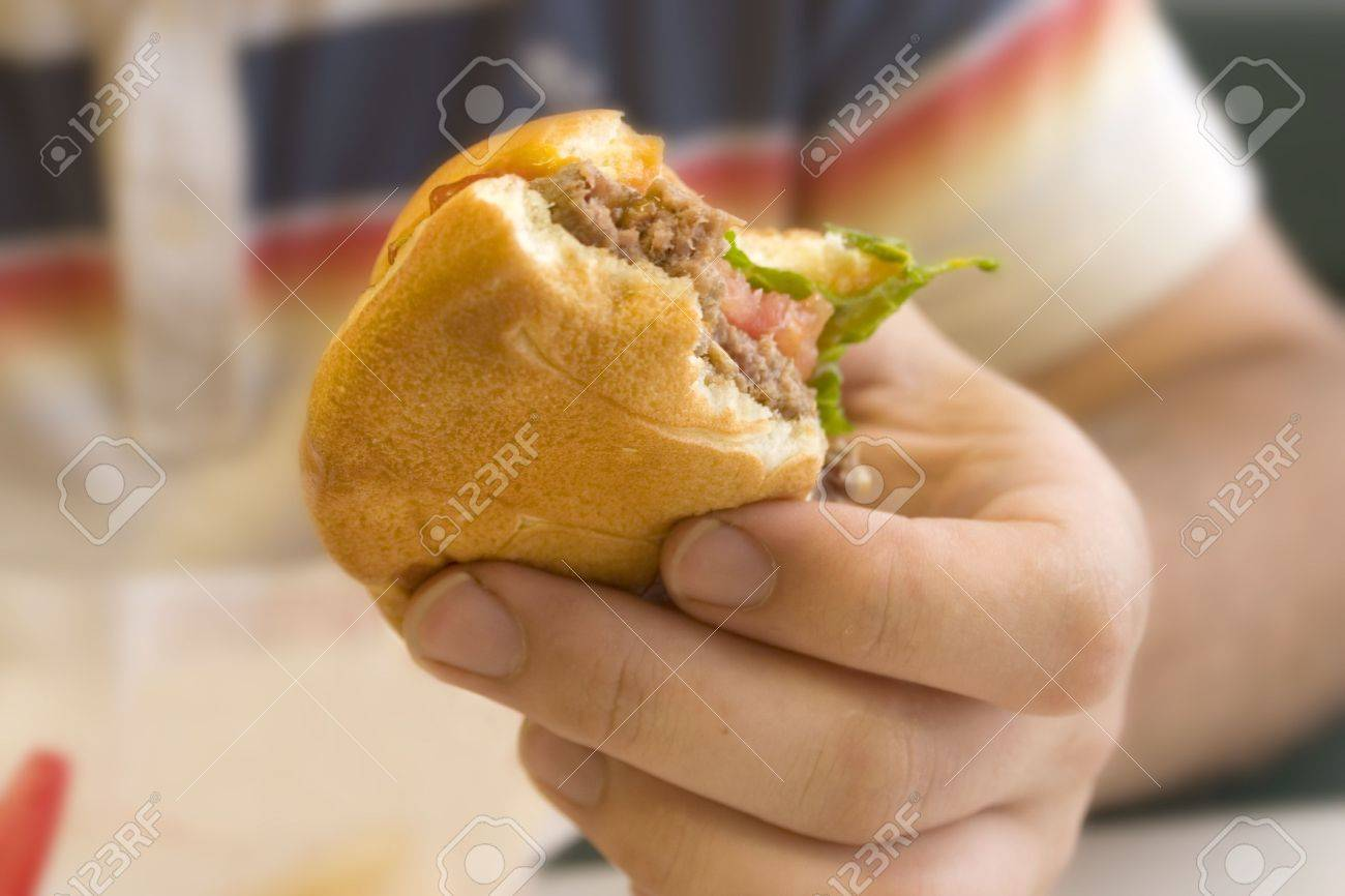 a man holding a half eaten hamburger Stock Photo - 1000407
