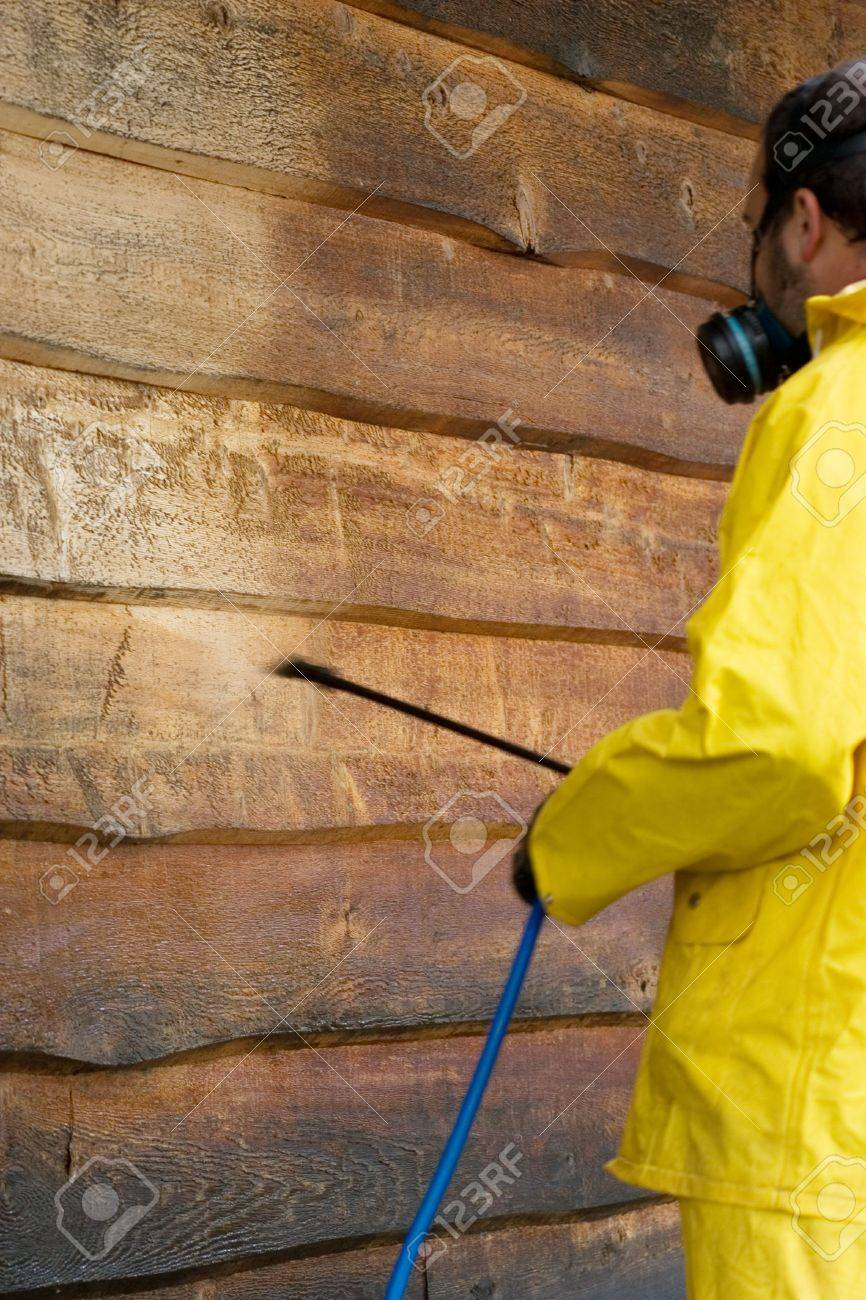 a man doing a chemical wash on the side of a garage Stock Photo - 2273830