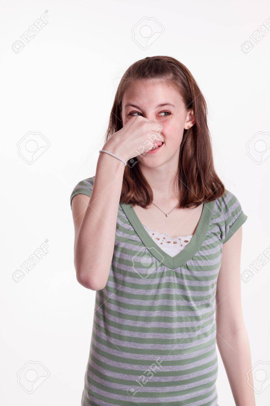 a young teenage girl holding her nose in disgust Stock Photo - 6663162