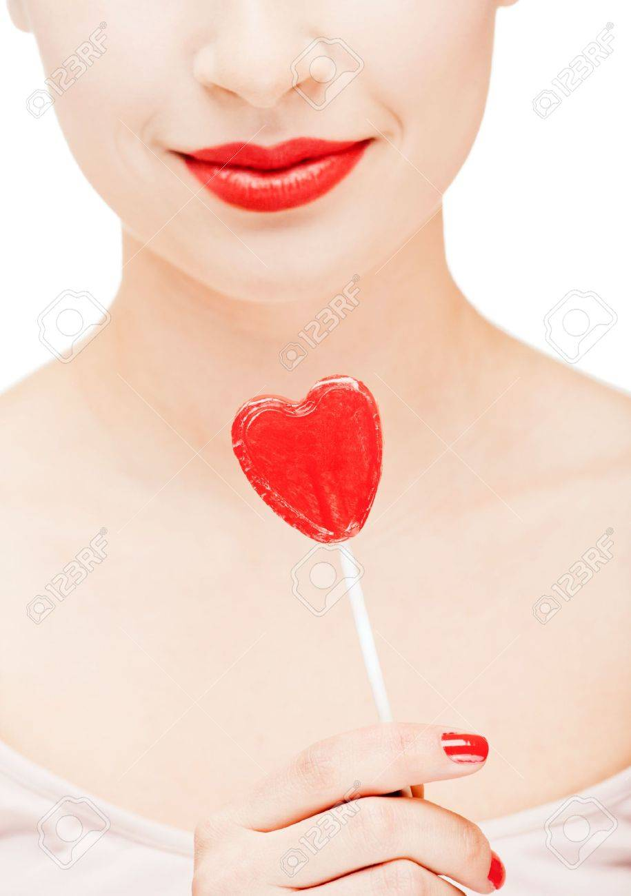 Girl with red lips holding a lollipop Stock Photo - 5707373