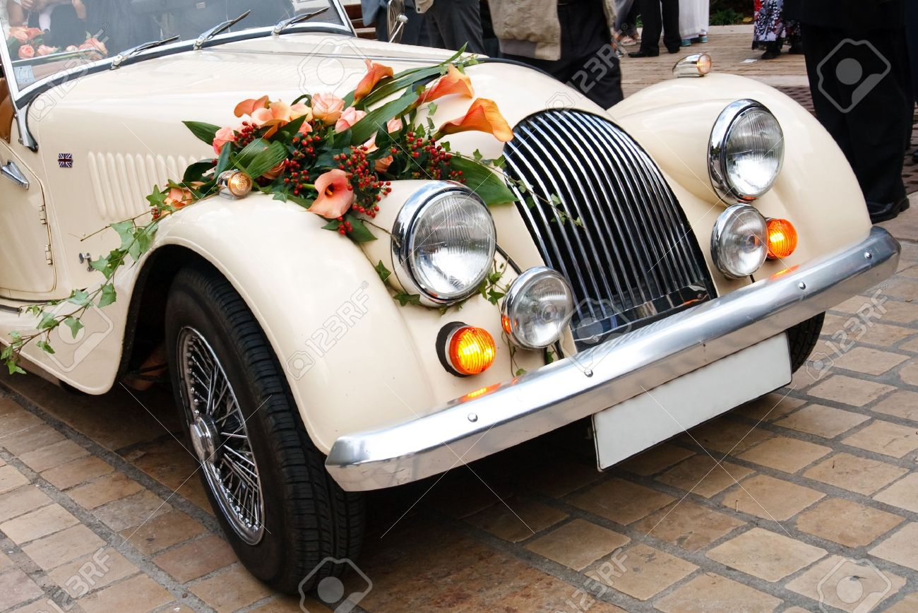 Vintage Wedding Car Decorated With Flowers. Stock Photo, Picture And ...