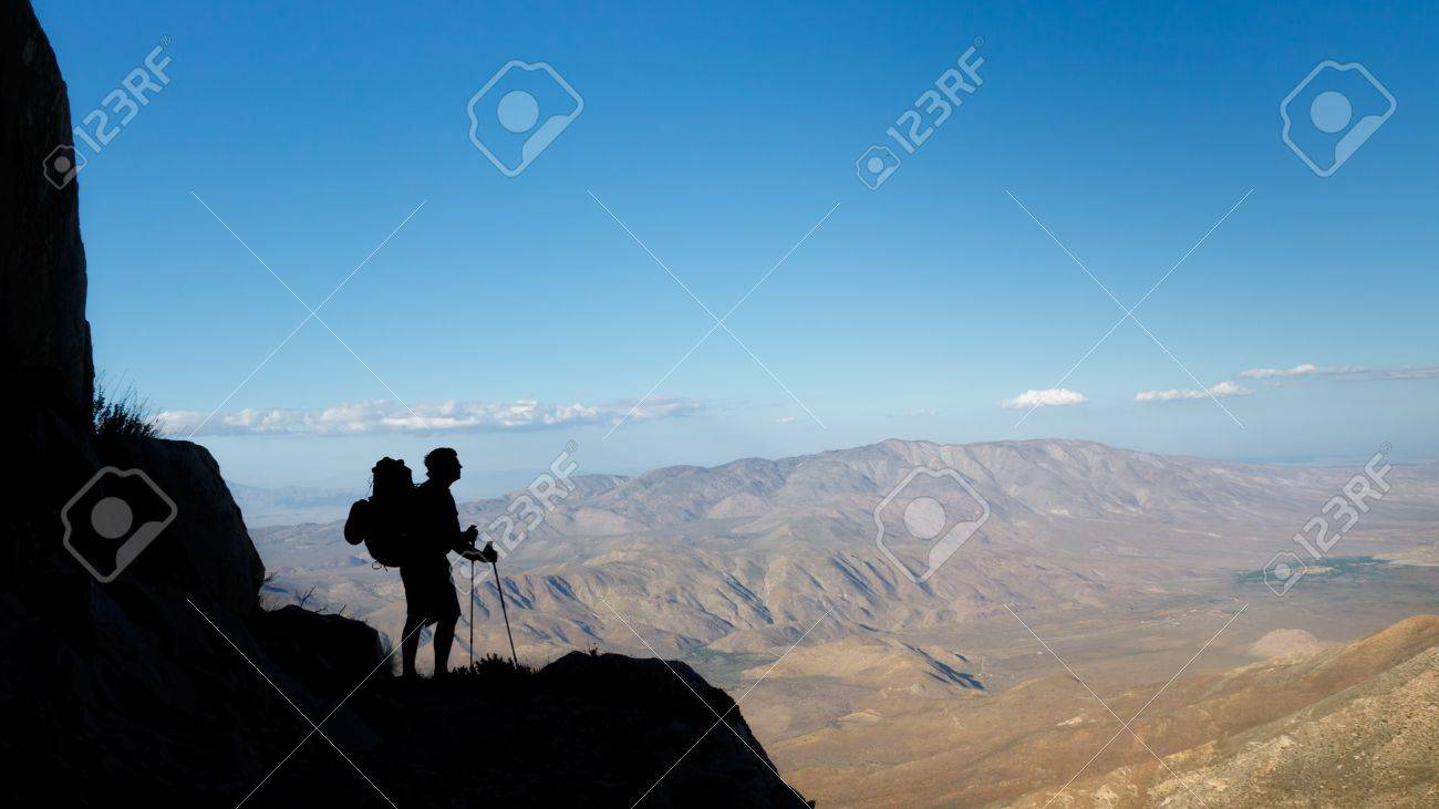 Desert Trekking Adventure - Silhouette of a hiker viewing Anza-Borrego Desert State Park, Southern California, USA Stock Photo - 9679852