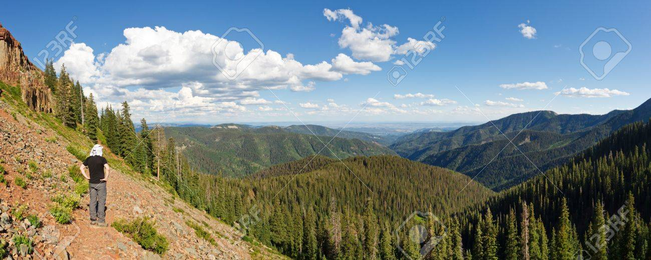 Hiker admires the view of the San Juan National Forest, Colorado, from the Colorado Trail near Durango. Stock Photo - 12597690