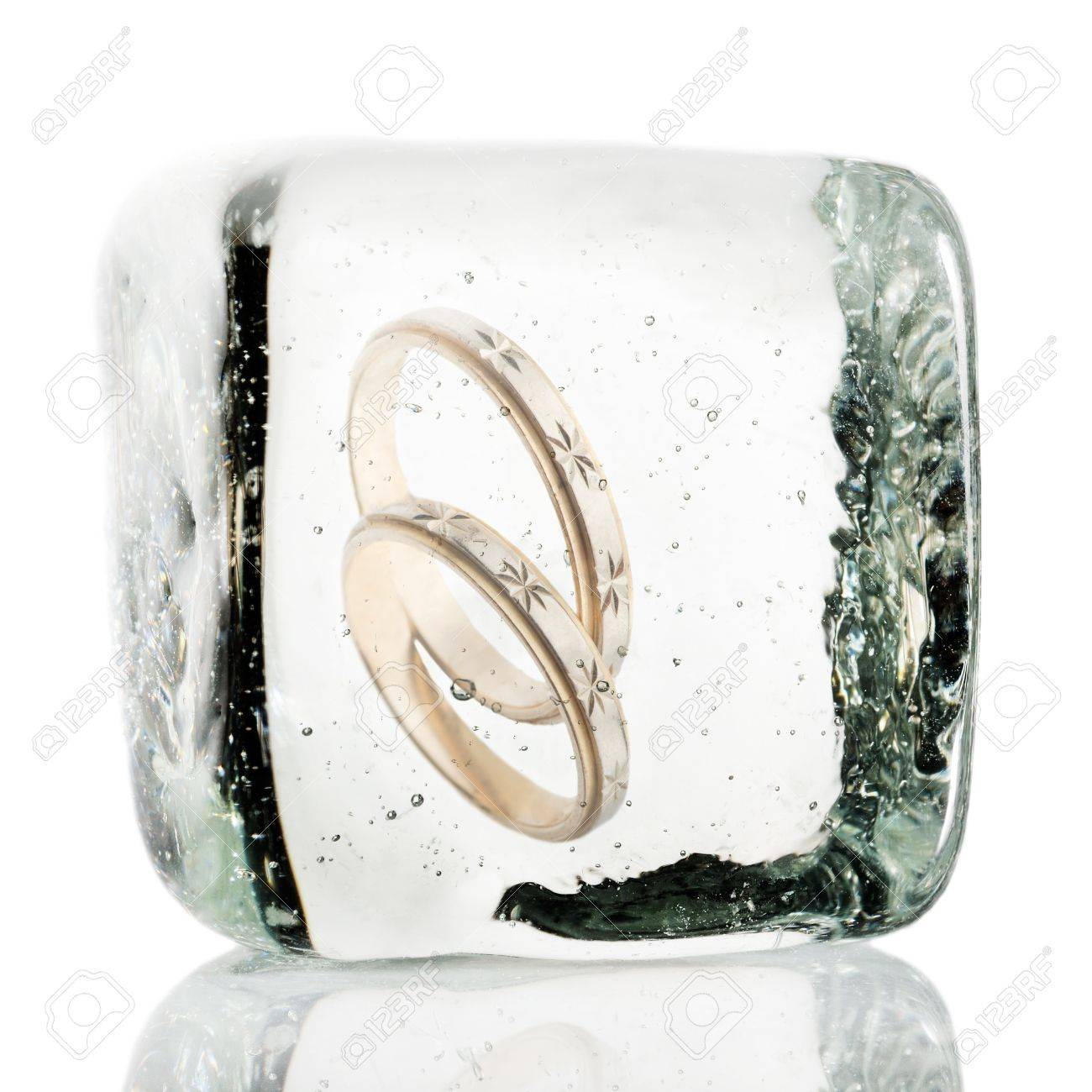 Engagement rings frozen in a block of ice Stock Photo - 20861213