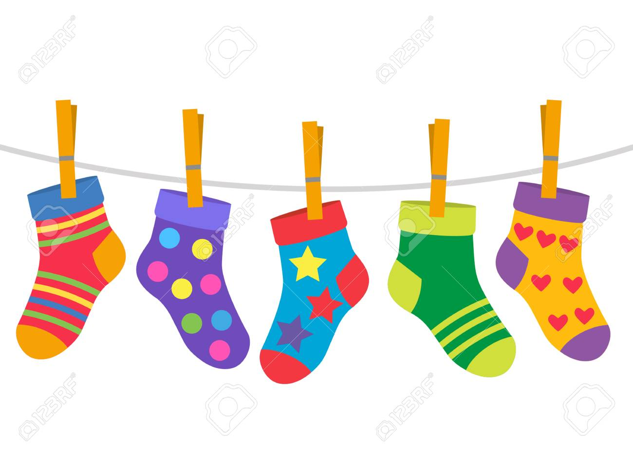 a set of children's socks are dried on a rope. black and white background - 107029508