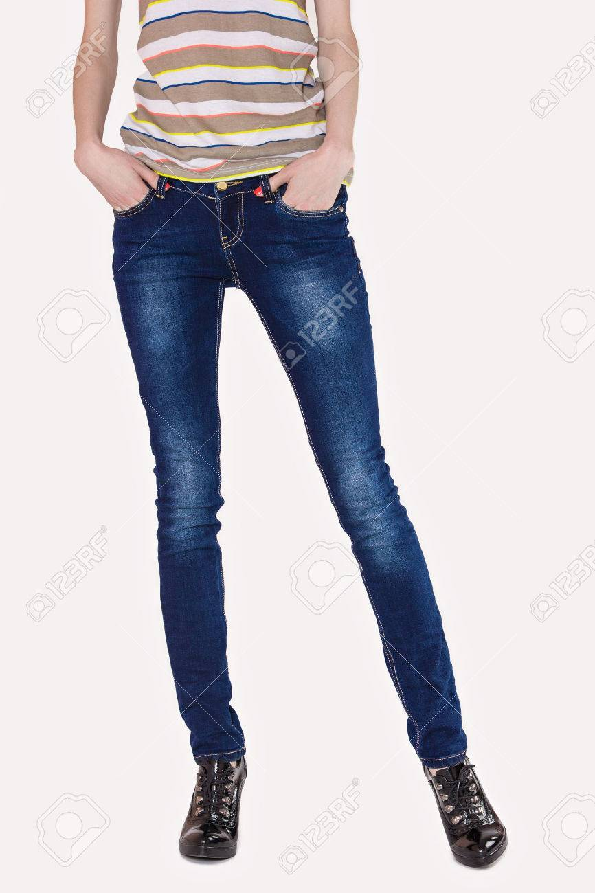 c1d516eaab Shapely female legs dressed in dark blue jeans and black varnished boots on  light Stock Photo