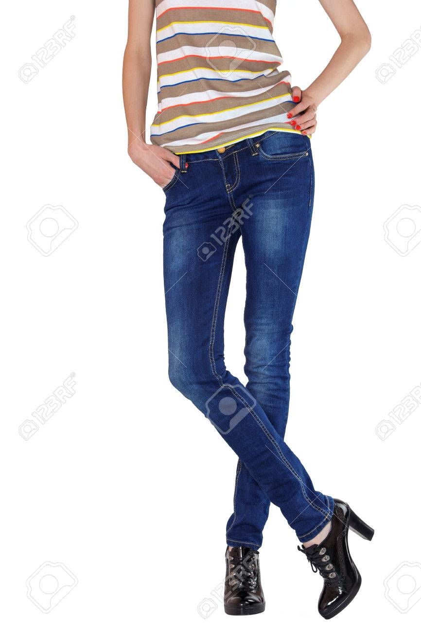 856f19a058 Shapely female legs dressed in dark blue jeans, striped shirt and black  varnished boots on