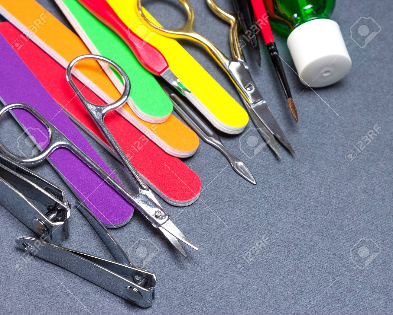 Various Manicure Tools On Gray Textured Surface. Nail Clippers ...