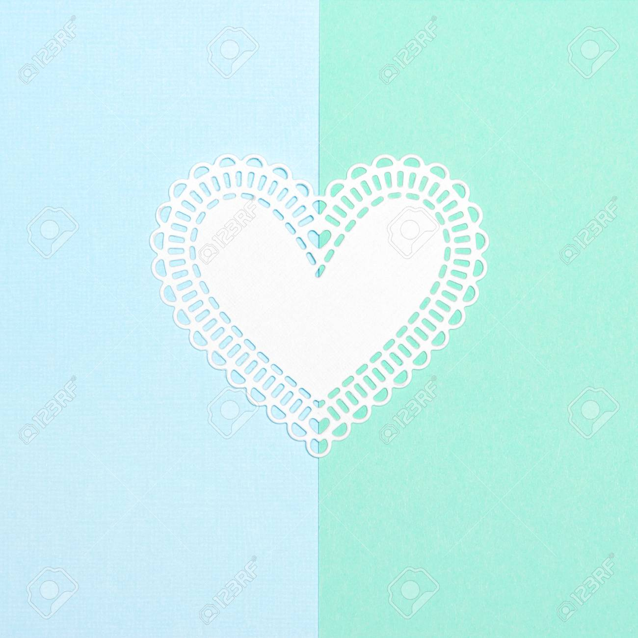 White Paper Heart On Blue And Turquoise Pastel Background Love