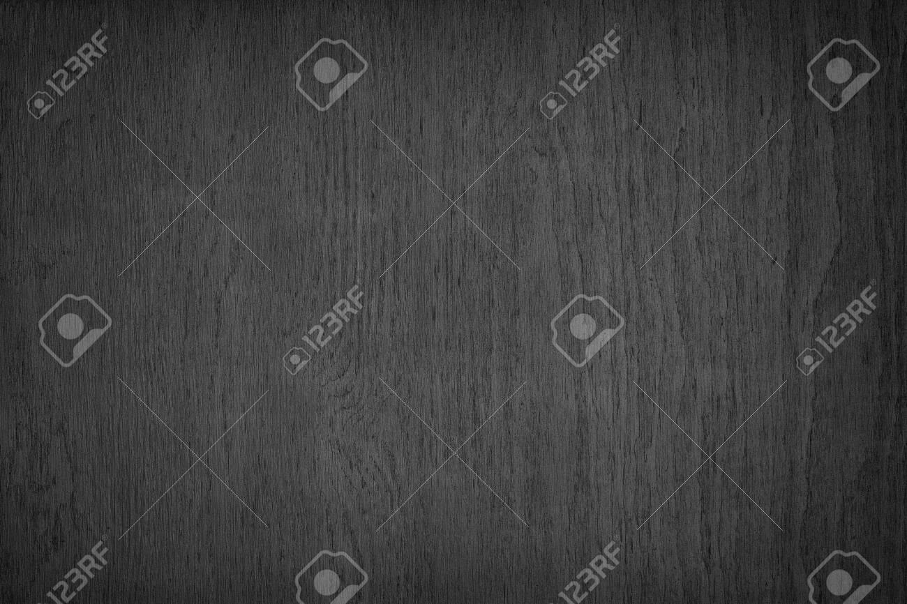 Black plywood rough surface texture. Dark wood backdrop. Abstract wooden background - 152476385