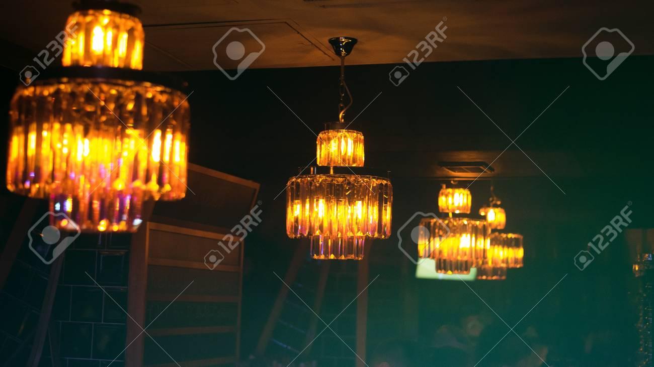 Closeup view of contemporary light fixture in dark room