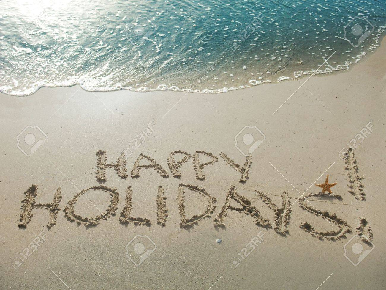 Happy Holidays! written in sand at the beach Stock Photo - 15381863