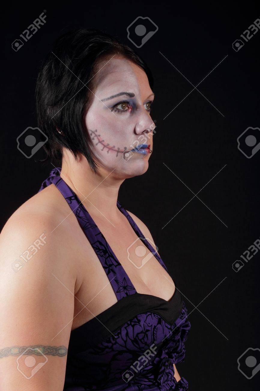 A woman with makeup for halloween - Two Face Stock Photo - 16549599