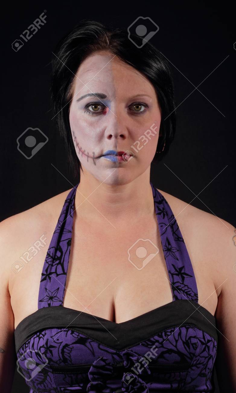 A woman with makeup for halloween - Two Face Stock Photo - 16549594
