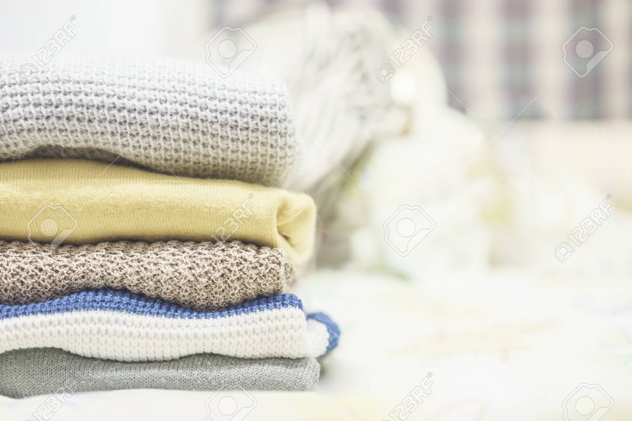 Winter clothes,Stack of clothes from knitted knitwear,vintage..