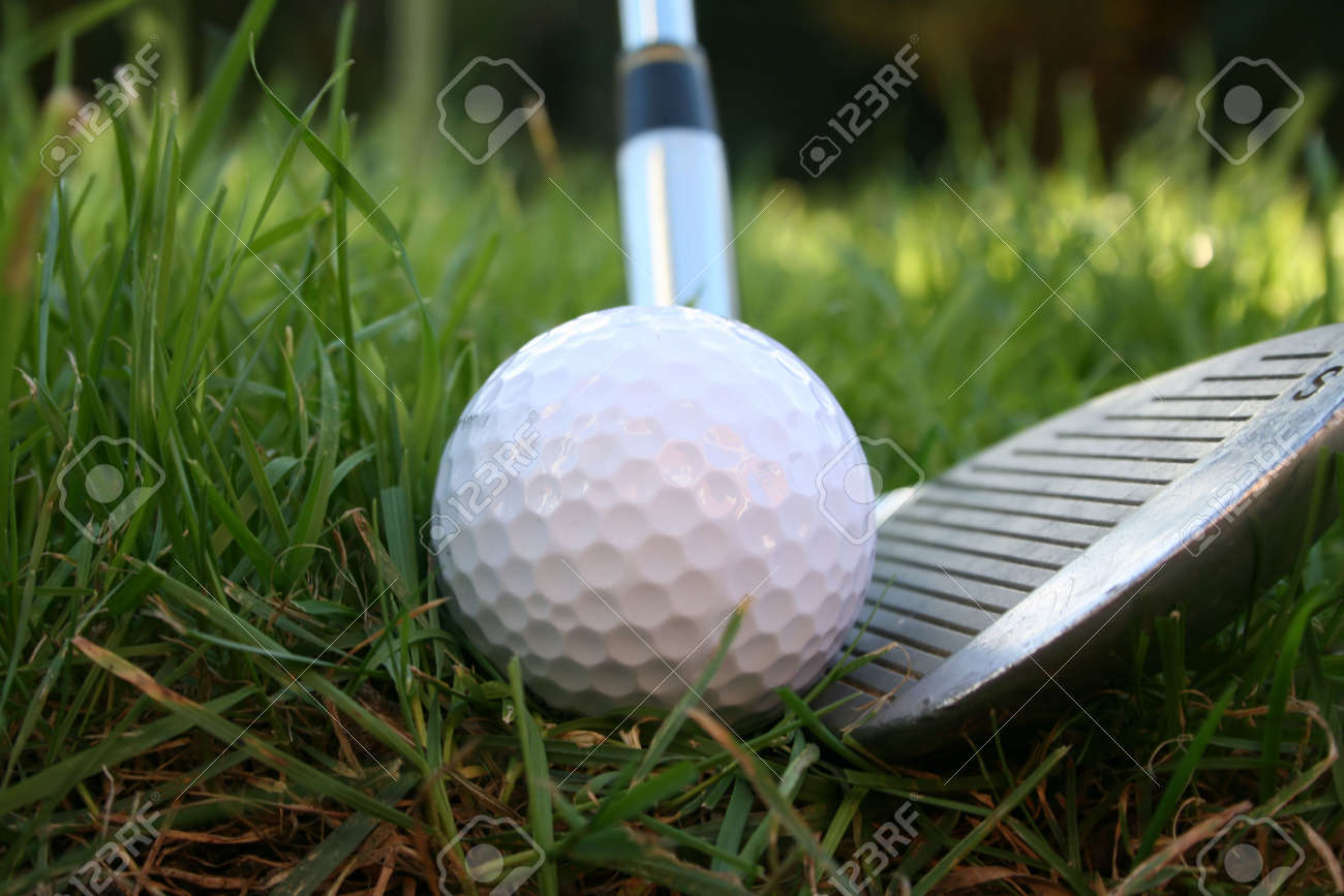 Iron about to hit a golf ball from the rough - low angle shot Stock Photo - 661499