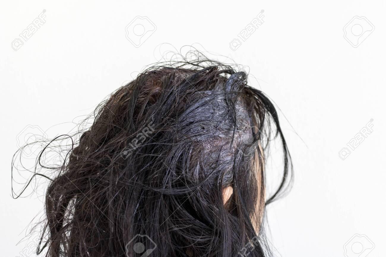 Head of an elderly woman dyeing gray hair - 147699844