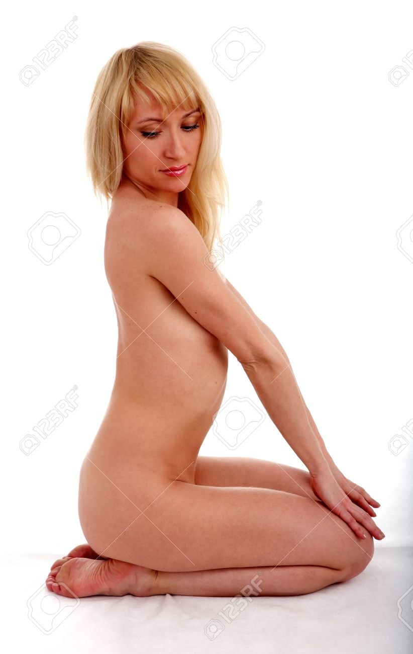 Nude Sexy Woman On Knell On A White Background Stock Photo 5554597