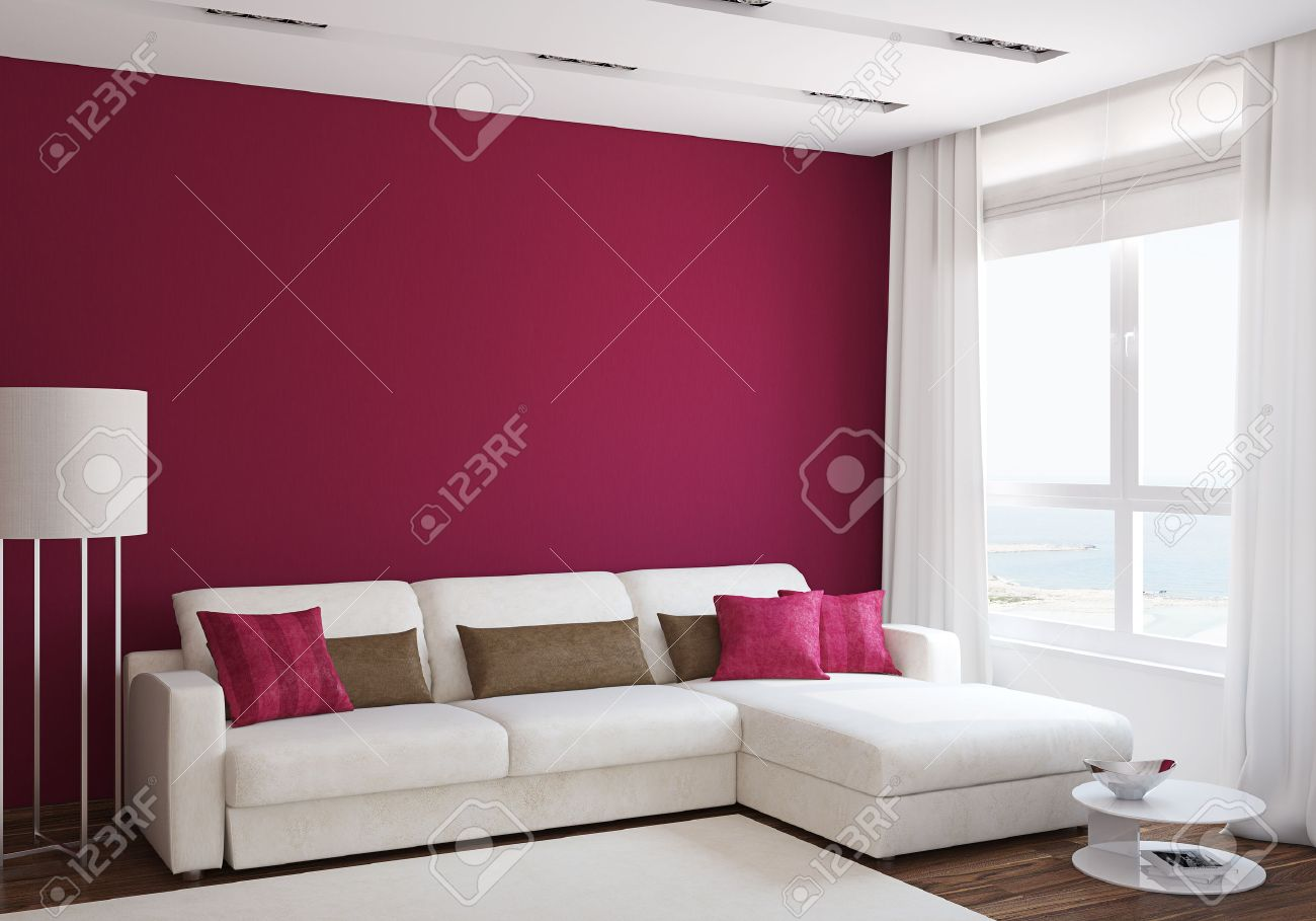 Modern living-room interior with white couch near empty red wall...