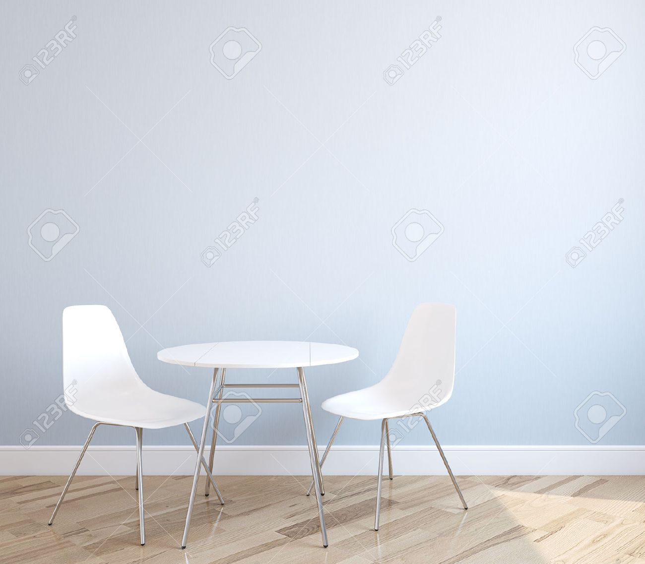 mesa con sillas interior con una mesa y dos sillas blancas cerca de la pared