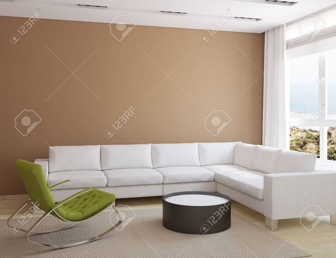 Moderne Wohnzimmer Inter Mit Weißen Couch Und Grünen Sessel In Der Nähe Von  Braunen Wand.