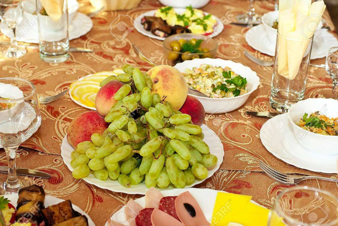 Dinner table with food - Dining Table With A Great Abundance Of Different Food Stock Photo 7696825