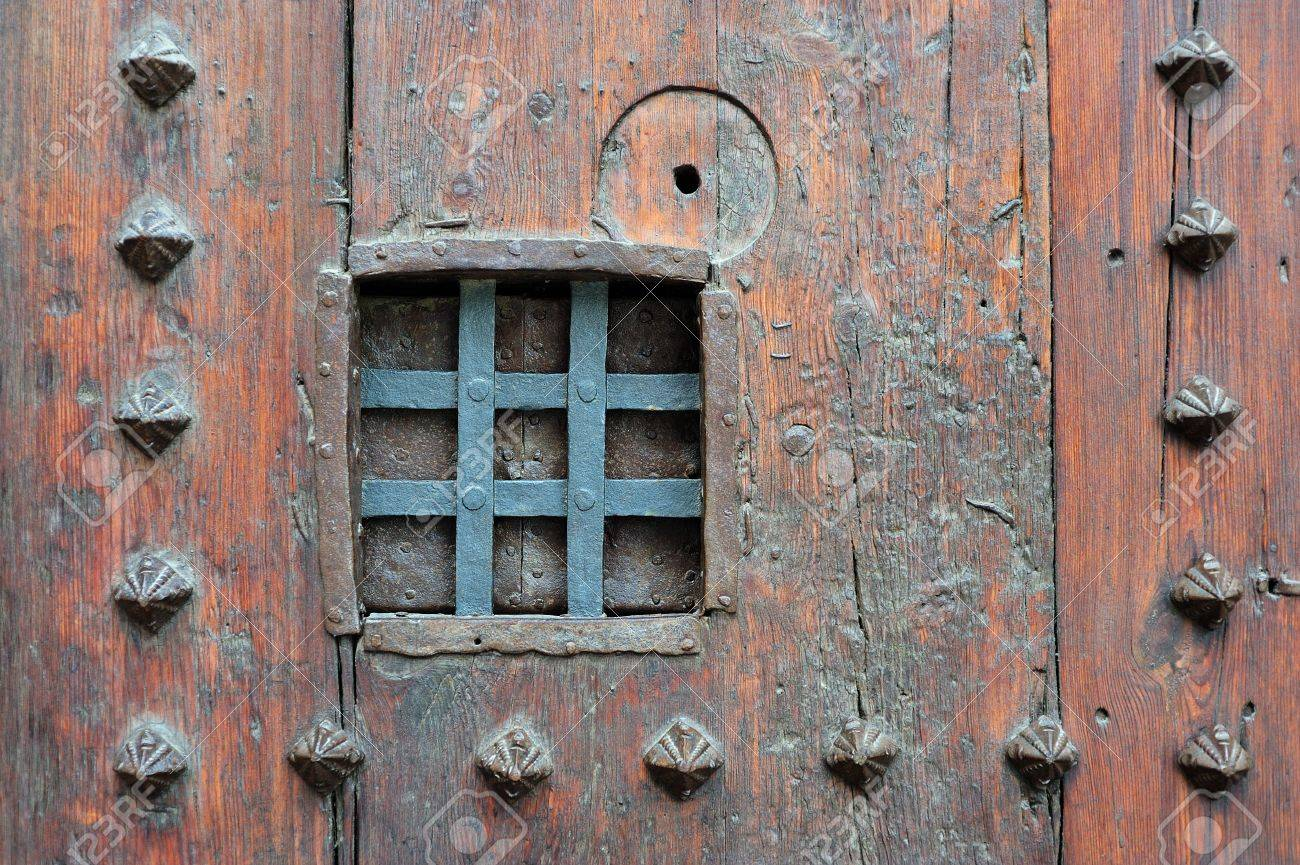 Small Window With Metal Bars To Look Through A Medieval Wooden