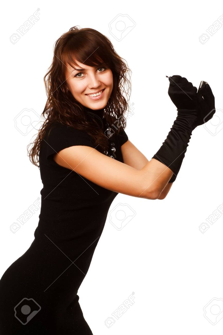 The girl in black clothes on a white background with a hat hat Stock Photo - 4714002