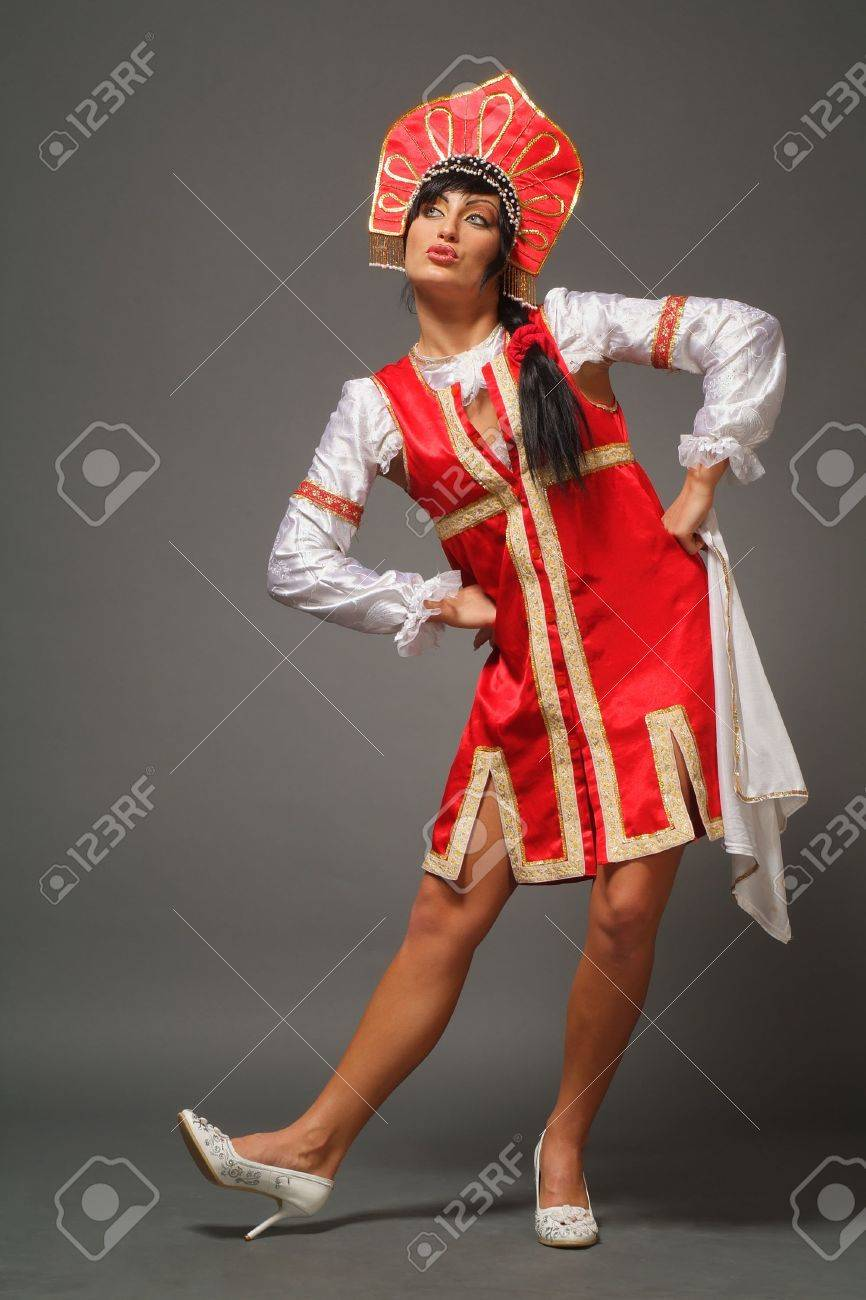 The Russian woman in ancient clothes on a grey background Stock Photo - 4737881