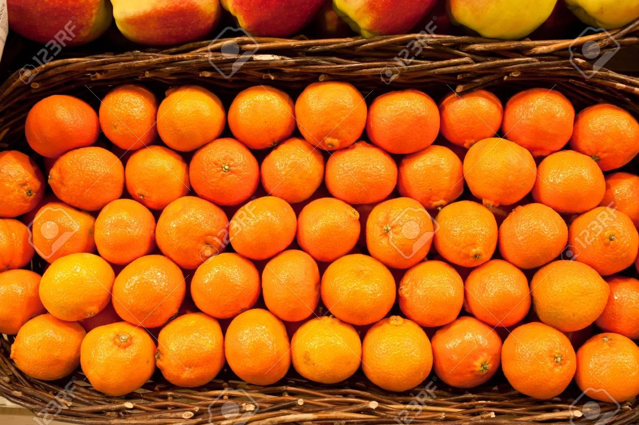 Ripe tangerines in a wattled basket Stock Photo - 12860477