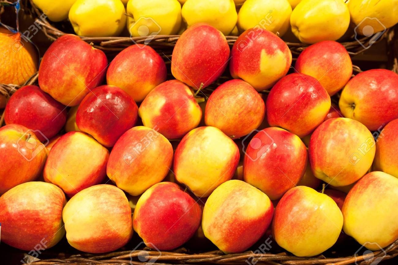 Ripe apples in a wattled basket Stock Photo - 12860454