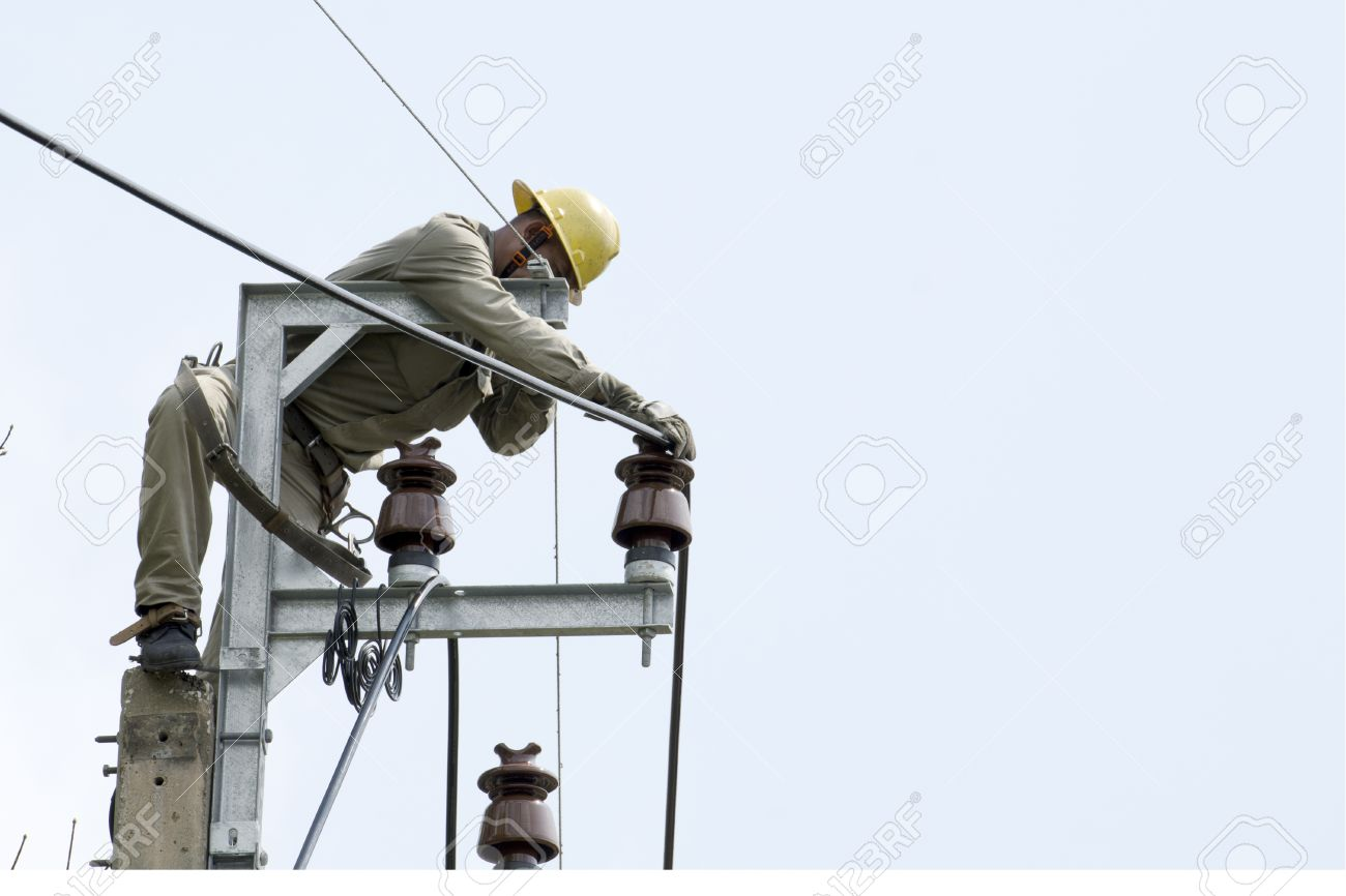 one electrician lineman at climbing work on electrical post power