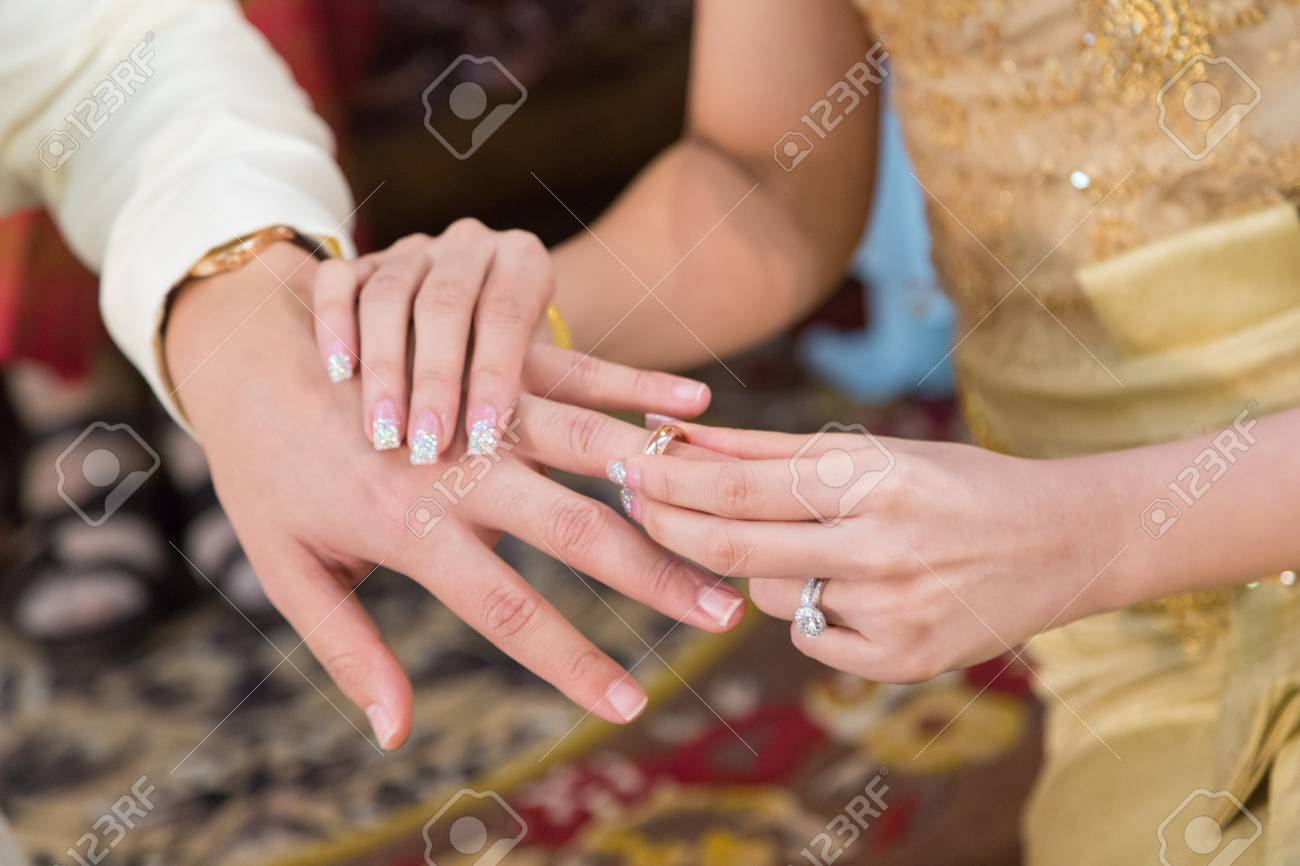 The Bride Wearing A Wedding Ring For Her Groom Stock Photo, Picture ...