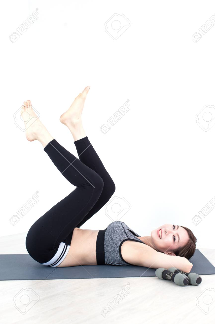 c953a86bba4cd Stock Photo - Young Fitness Asian woman doing exercises with dumbbells