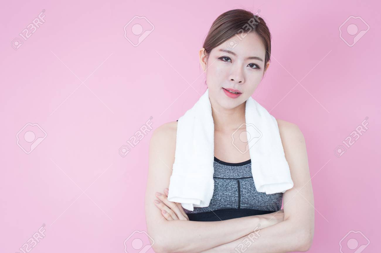 e584bc199d Young Fitness Asian girl ware sports bra on pink background with copy space  Stock Photo -