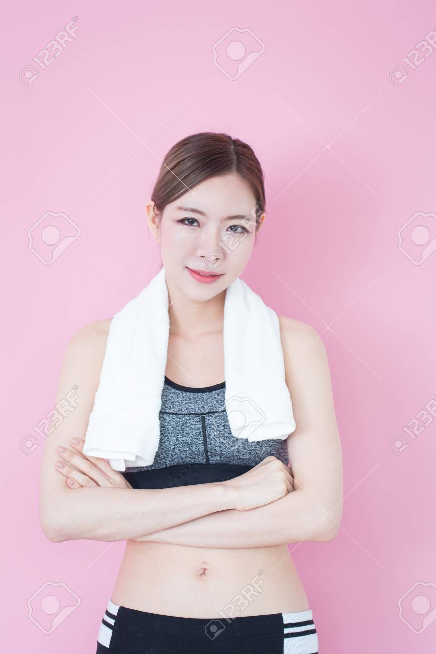 7ecc04c9b18ac Young Fitness Asian girl ware sports bra on pink background with copy space  Stock Photo -