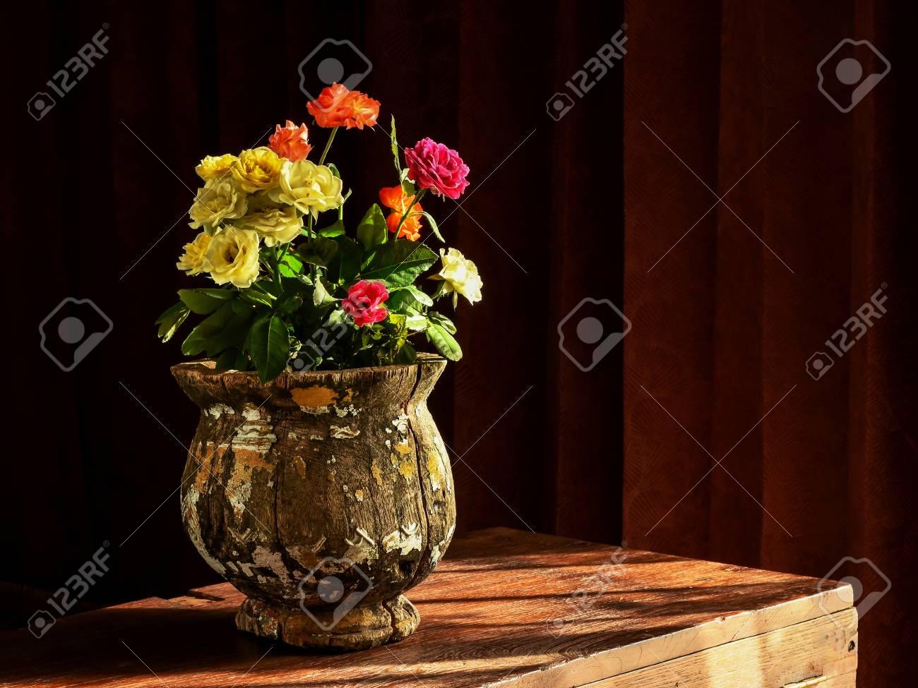 Still life of flower vase. Arrangement of country rose in vintage wooden vase lights up & Still Life Of Flower Vase. Arrangement Of Country Rose In Vintage ...