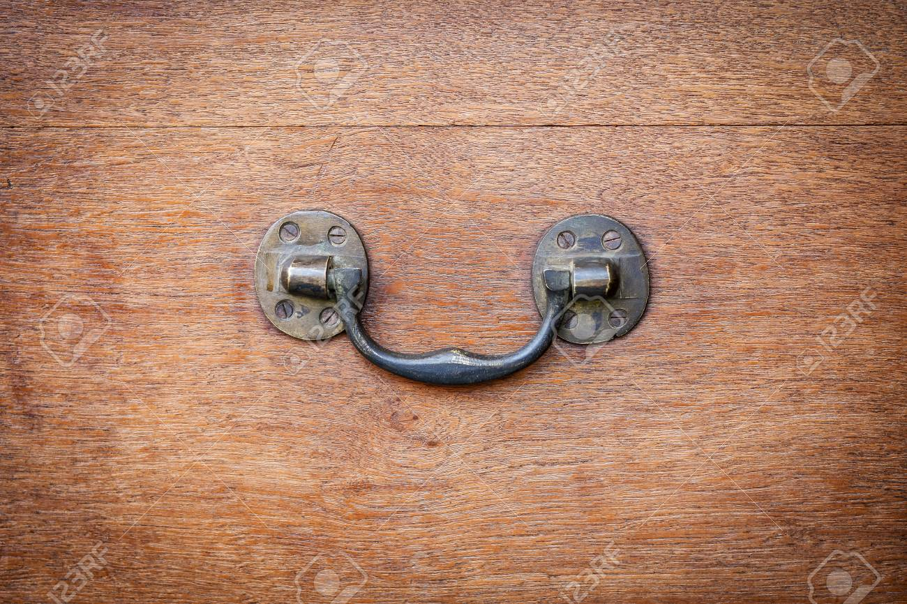 Brass side handle of vintage wooden chest. Antique furniture hardware  detail. Stock Photo - - Brass Side Handle Of Vintage Wooden Chest. Antique Furniture.. Stock