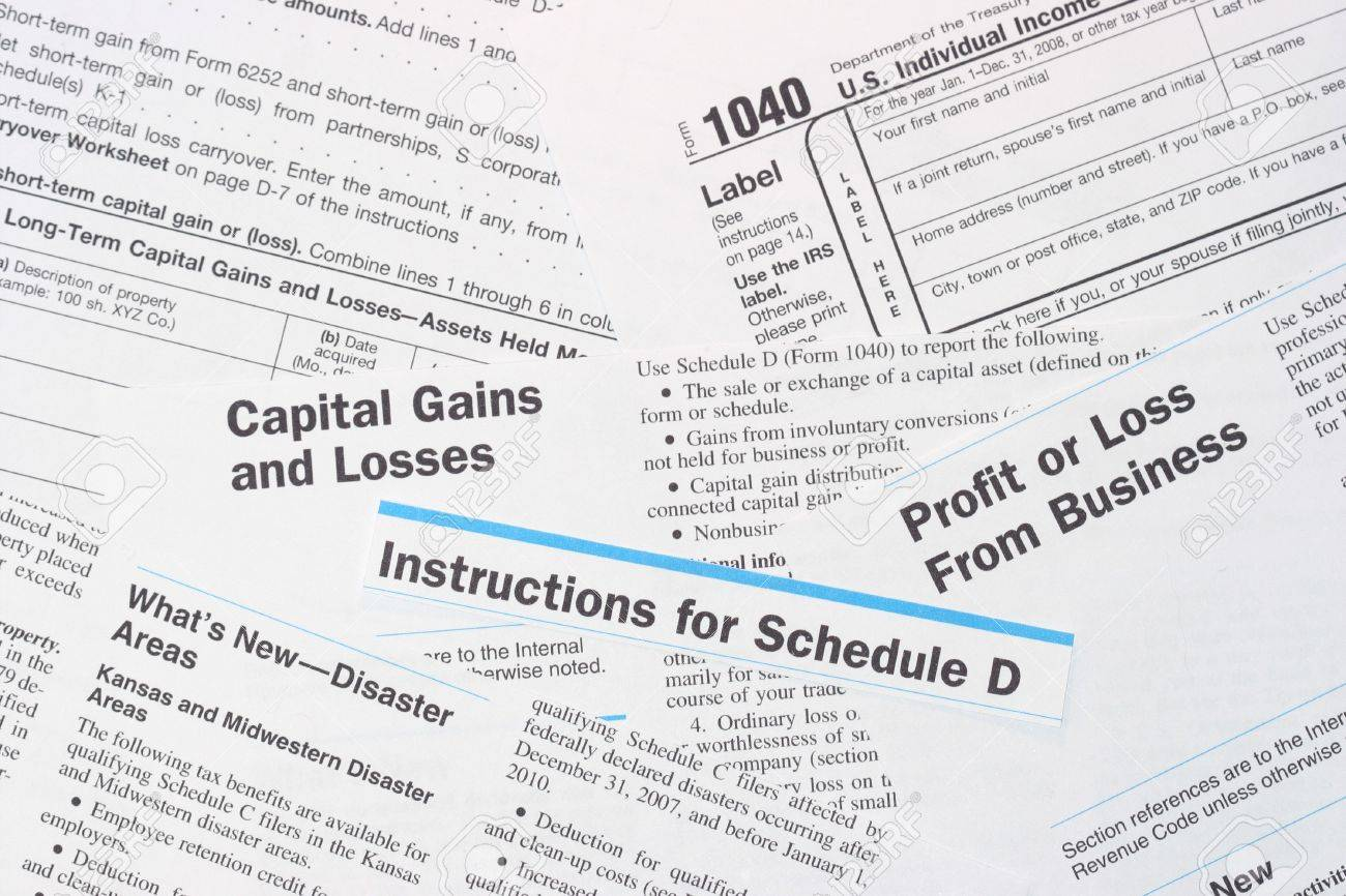 IRS Federal Income Tax Forms 1040 And Schedule D Stock Photo ...