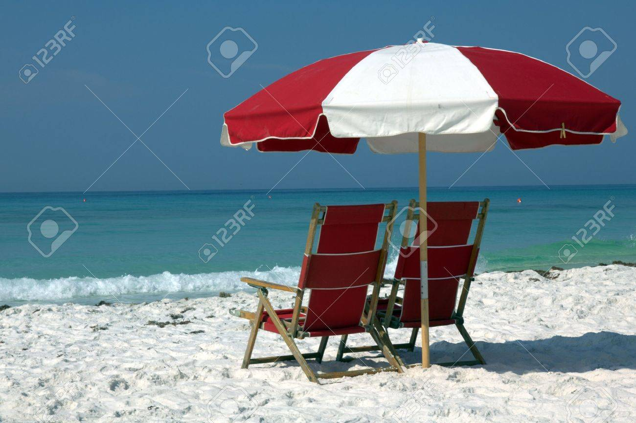 Beach chair and umbrella black and white - Beach Umbrella Two Chairs And Umbrella On White Sand Beach Stock Photo