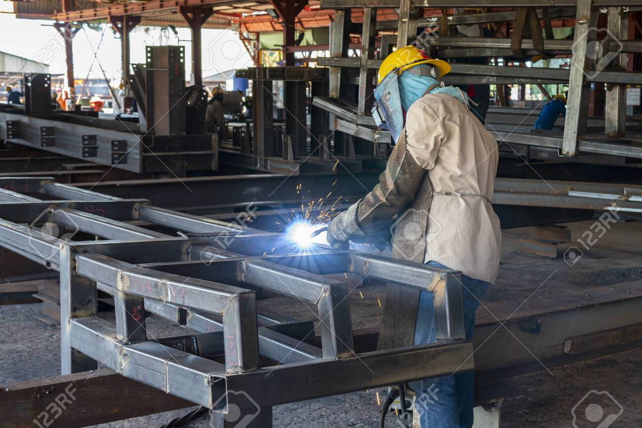 The Welder Is Welding A Steel Structure Work With Process Flux Stock Photo Picture And Royalty Free Image Image 145486414