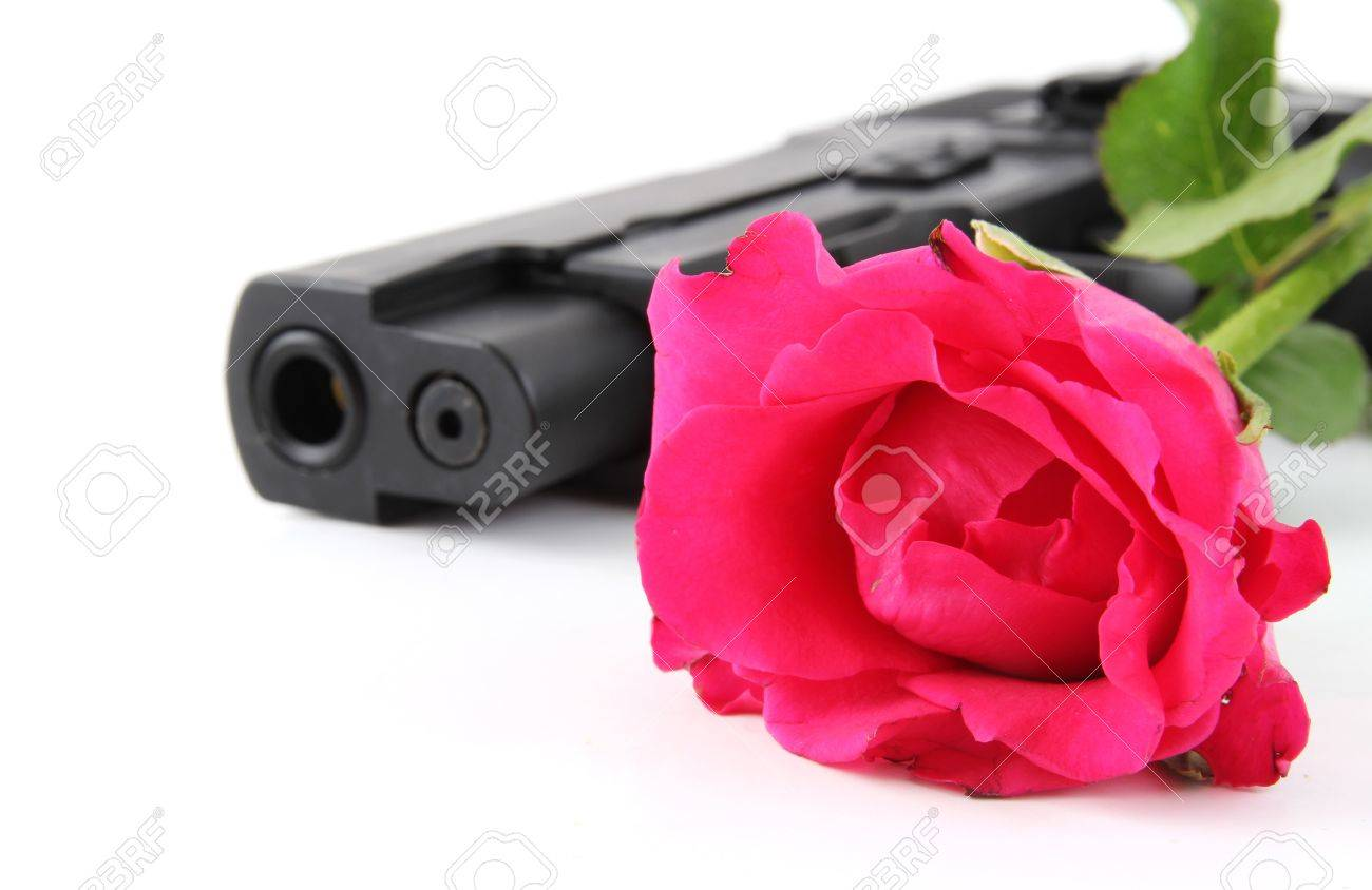Red rose and black pistol on white background Stock Photo - 10615298